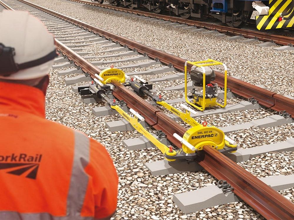 rail stressor positioned on a railway trackj